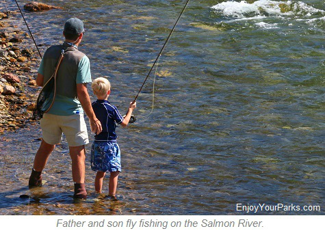 Father and son fly fishing on the Salmon River in Idaho