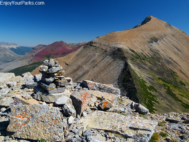 Triple Divide Peak summit cairn with Mount James in the distance, Glacier National Park