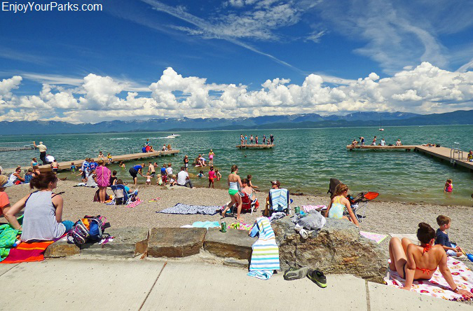 Visitors enjoying Flathead Lake at Lakeside, Montana