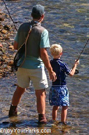 Father and son fly fishing, Idaho