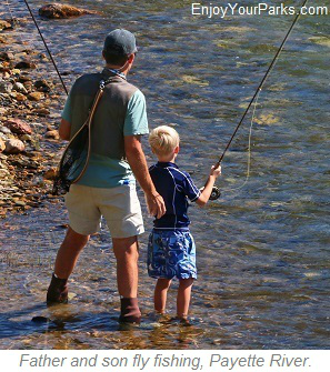 Father and son fly fishing on the Payette River, Idaho