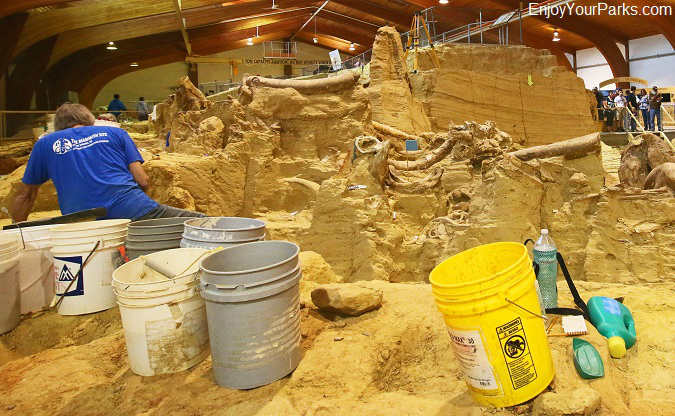 Paleontologist working at the Mammoth Dig Site at Hot Springs, South Dakota.