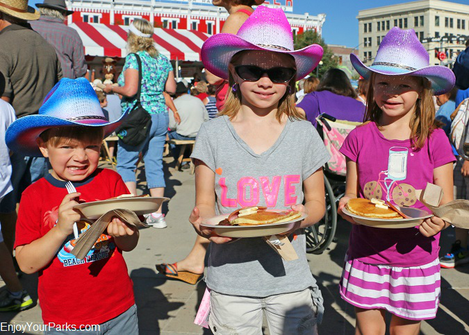 Young cow pokes enjoying the Cheyenne Frontier Days Free Pancake Breakfast