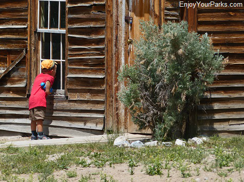 Young visitor exploring Bannack Montana