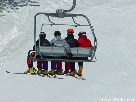 Skiers riding a chair lift at Big Sky Resort Montana